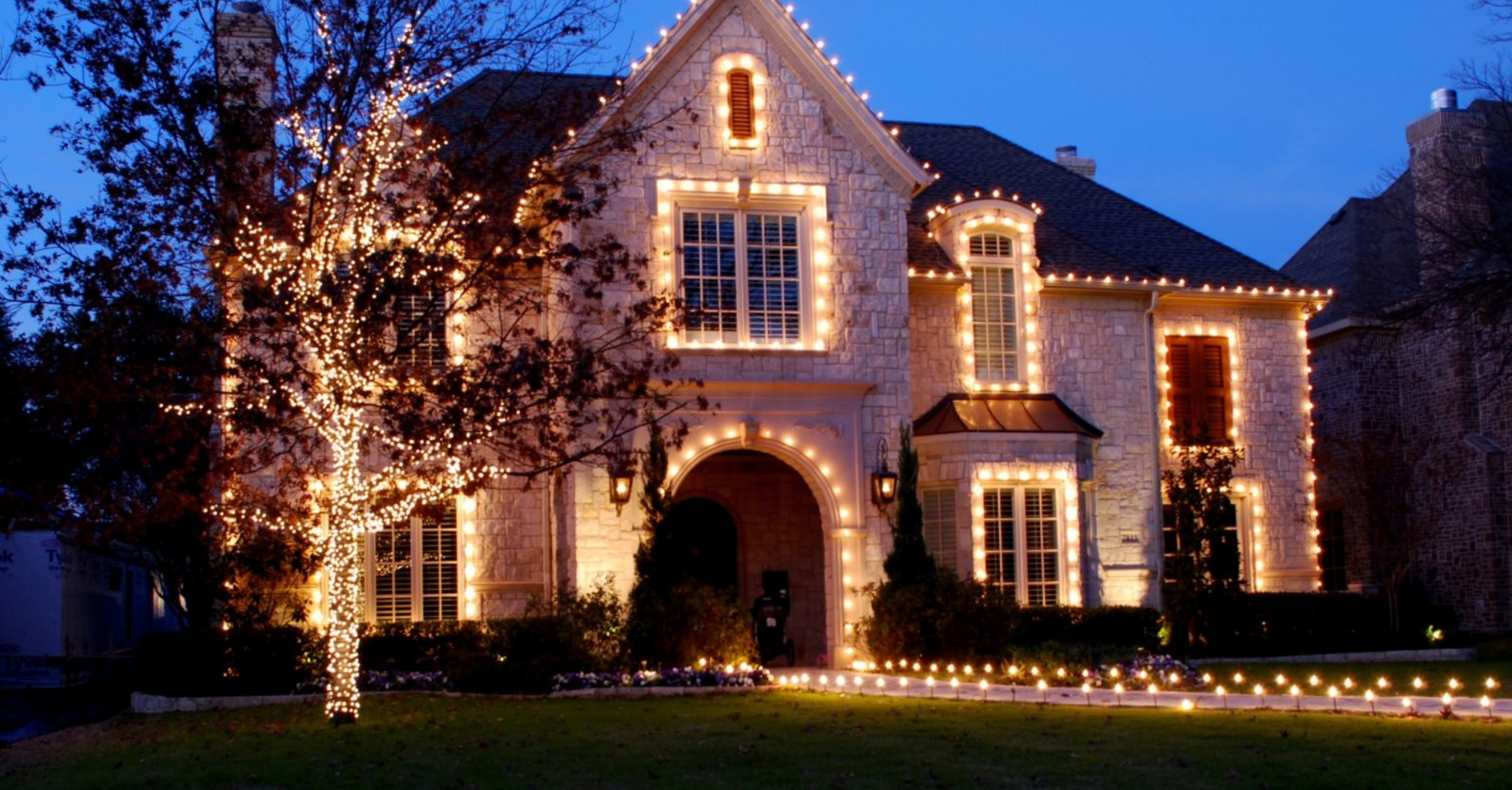 Example of white Christmas lights on a large Bakersfield home, taken at night, installed by The Light Guys